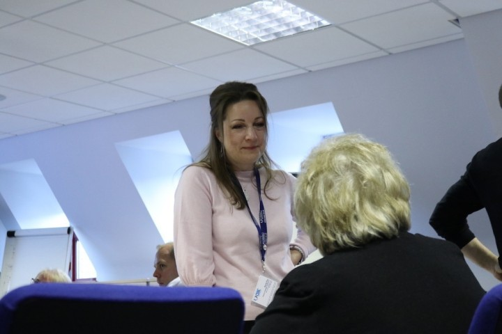 Board members talking in a meeting.