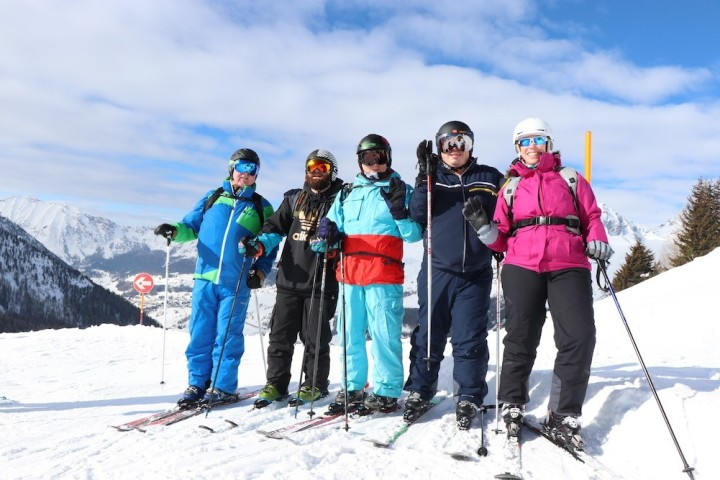 Group of friends wearing their skiing gear.