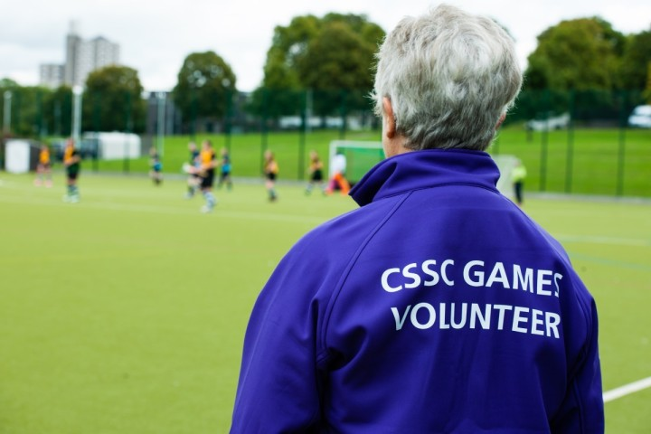 CSSC volunteer watches a hockey game in play
