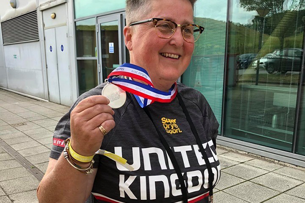 Clare holding her medal